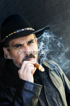 Bearded man smoking cigar