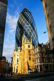 Gherkin building and church of St. Andrew Undershaft in London