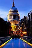 St. Paul&#39;s Cathedral  from Millennium Bridge in London at night