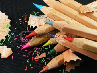 A pile of freshly sharpened colored pencils made of natural wood