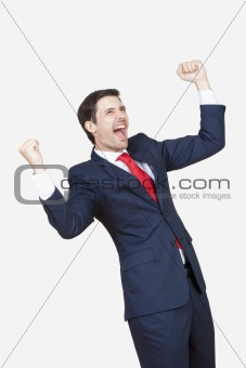 business executive in suit cheering isolated on white