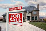 Foreclosure Home For Sale Sign and House with Dramatic Sky Background.