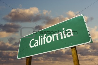 California Green Road Sign with dramatic blue sky and clouds.
