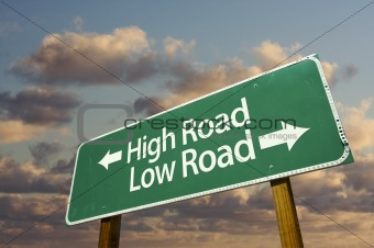 High and Low Road Green Road Sign with dramatic blue sky and clouds.