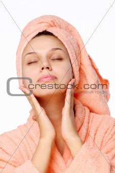Young woman with closed eyes get a pleasure after bath