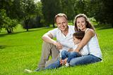 Joyful parents and small son