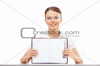 Girl with a weekly journal