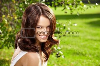 Charming woman in a garden