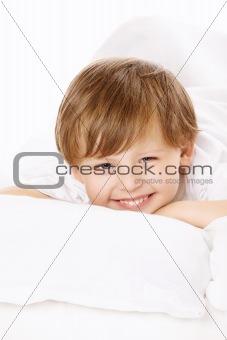 Portrait of boy in bed