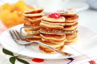 Sweet mini pancakes with pancake maker