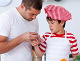 Boy hurt his finger and father treating it