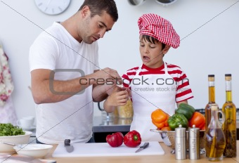 Boy hurt his finger cooking and father treating it