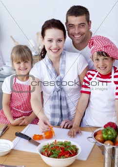 Happy family preparing lunch in the kitchen