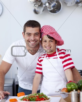 Father and son cooking a salad