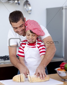 Man and little boy cutting bread