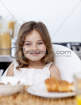 Little girl having breakfast