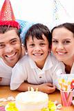 Smiling family celebrating son's birthday
