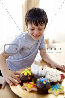 Happy boy looking at confectionery