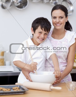 Boy baking with his mother in the kitchen