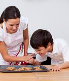 Mother and son baking biscuits in the kitchen