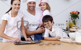 Smiling family baking in the kitchen