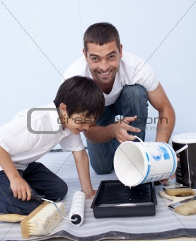 Father and son painting a bedroom