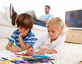 Children painting in living-room and father using a laptop