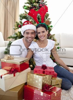 Couple celebrating Christmas at home
