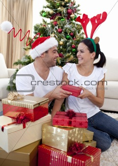 Happy couple giving presents for Christmas