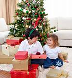 Brother and sister celebrating Christmas