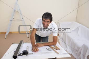 Smiling architect man decorating a bedroom