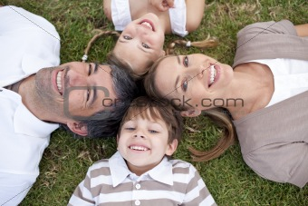 Tired family lying in a park