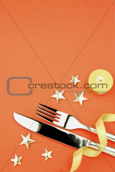 knife and fork with ribbon, stars, candle