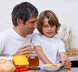 Portrait of father and son having breakfast together