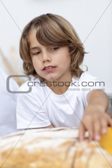 Little boy eating bread