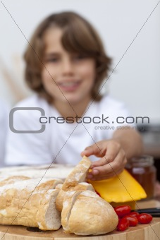 Close-up of child's hand taking bread