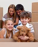 Little boy and girl moving house with parents