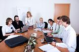Young team working together in a conference room