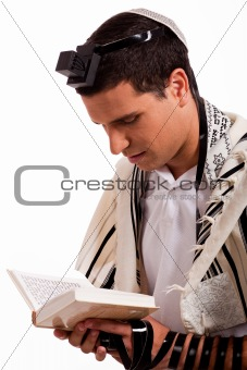 Close up of a young  jewish man with book