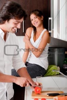 boyfriend sliceing tomottos with his girlfriend
