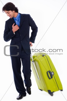 Corporate man looking down with is luggage