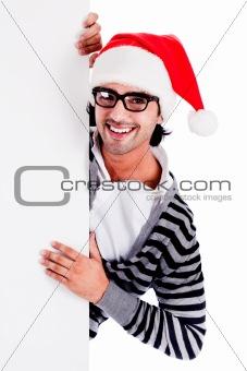 Santa pointing down at blank billboard