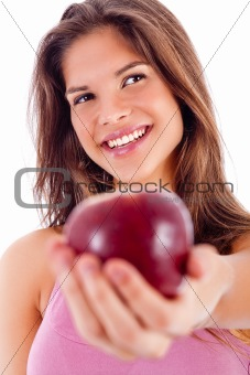 portrait of happy girl showing red apple