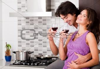 Couple drinking wine in their kitchen