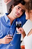 man looking his wife with wine