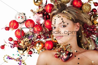 Beautiful female with Christmas decoration on white