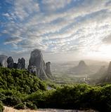 misty at sunset on rocks of Meteora, Greece