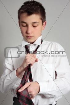 Boy getting dressed for school