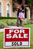 African American Couple Celebrating House Purchase Behind For Sa
