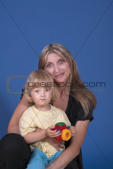 portrait of mother and son  with colorful plastic toy camera